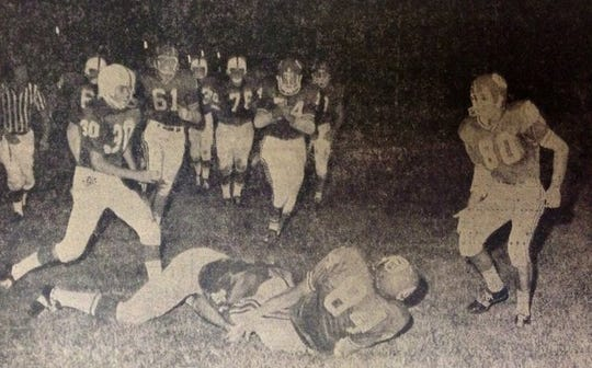 Gary Parris (84) scored the first touchdown in Citrus Bowl history with a 13-yard reception from Mark Baker against Melbourne on Sept. 13, 1967. Teammates Tom Kauffman (80), Robert Brothers (61) and Howard Avril (74) celebrate.