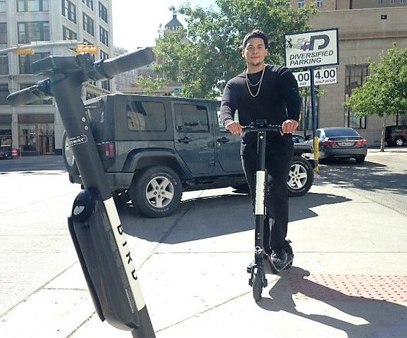 Joey Martinez, a Bird electric scooter employee in El Paso, drops scooters in Downtown on Oct. 26.