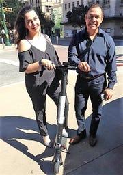 El Pasoans Dorali Licon and Hugo Saldana prepare to ride a Bird electric scooter near the Mills Building in Downtown El Paso.