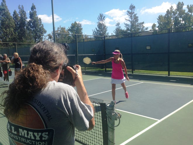 Pippa Gossett takes a swing for a photo shoot. One of these photos taken by photographer Joseph Peduto will appear in a calendar that features the female players of Simi Valley Pickleball. Proceeds from calendar sales will benefit the Simi Valley YMCA.
