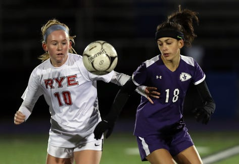 From left, Rye's Eve Dalton (10) and John Jay's Adeline Angelino (18) battle for ball control during girls soccer playoffs at John Jay High School in Cross River Oct. 25, 2018. John Jay won the game 2-1 in double overtime.