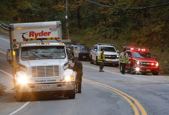 A tow truck prepares to haul away a rental truck at the scene of a head-on crash on Route 6 in Somers on Oct. 26, 2018.
