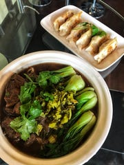 Braised beef noodle soup and pan fried dumplings at Mr. Chen in Mamaroneck. Photographed Oct. 26, 2018.