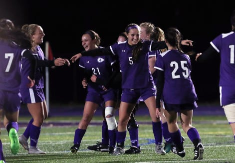 John Jay players celebrate their 2-1 victory over Rye in double overtime at John Jay High School in Cross River Oct. 25, 2018.