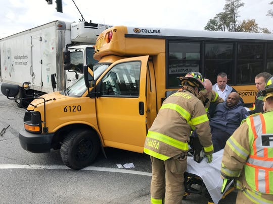 Rescuers remove injured bus monitor from bus after it collided with a box truck on Rt. 22 and Doansburg Road in Southeast Oct. 26, 2018. There were no children on the bus.