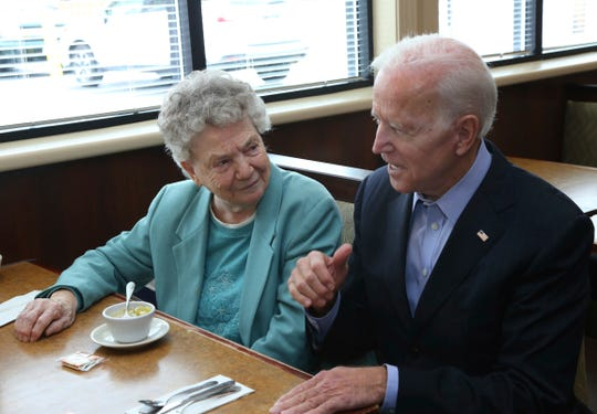 Former Vice President Joe Biden talks to a patron during a campaign meet and greet with workers and patrons in a restaurant, Thursday, Oct. 25, 2018, in Lancaster N.Y. A law enforcement official said a suspicious package addressed to former President Joe Biden were intercepted at Delaware mail facilities in New Castle and Wilmington and were similar to crude pipe bombs sent to former President Barack Obama, Hilary Clinton and CNN. (AP Photo/Jeffrey T. Barnes)
