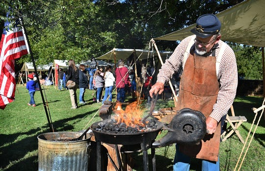 Timothy Phillips, proprietor of Taylor County Forge, was one of many living history demonstrators at the Fort Belknap Living History Days event Friday morning. Phillips showed how tools an implements were fashioned from red-hot steel.
