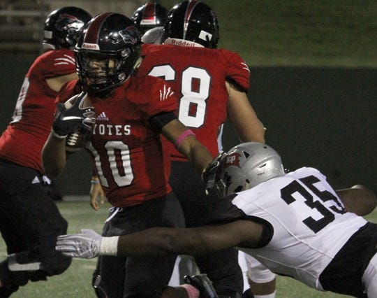 Wichita Falls High School's Isiah Cherry is tackled by Lubbock Cooper's Brysan Robertson Thursday, Oct. 25, 2018, at Memorial Stadium.