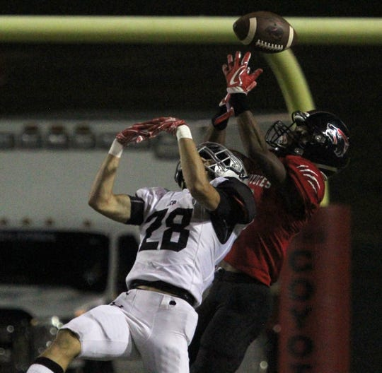 Lubbock Cooper's Rylan Wilcox disrupts the pass to Wichita Falls High School's A.J. Byrd Thursday, Oct. 25, 2018, at Memorial Stadium in Wichita Falls.