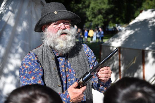 Dennis Guenter, a member of Sons of Confederate Veterans, talks about a LeMat revolver used in the Civil War during a presentation to students attending the Fort Belknap Living History Days event Friday morning.