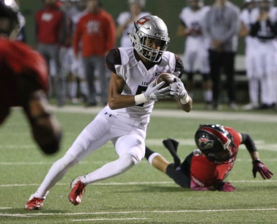 Lubbock Cooper's Jawaun Johnson runs for a first down against Wichita Falls High School Thursday, Oct. 25, 2018, at Memorial Stadium.