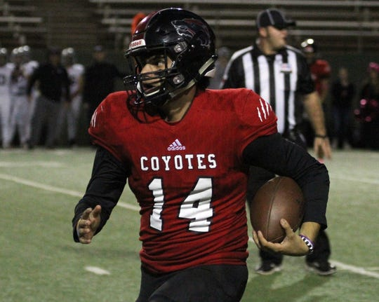 Wichita Falls High School's Anthony Vargas runs for a first down against Lubbock Cooper Thursday, Oct. 25, 2018, at Memorial Stadium.
