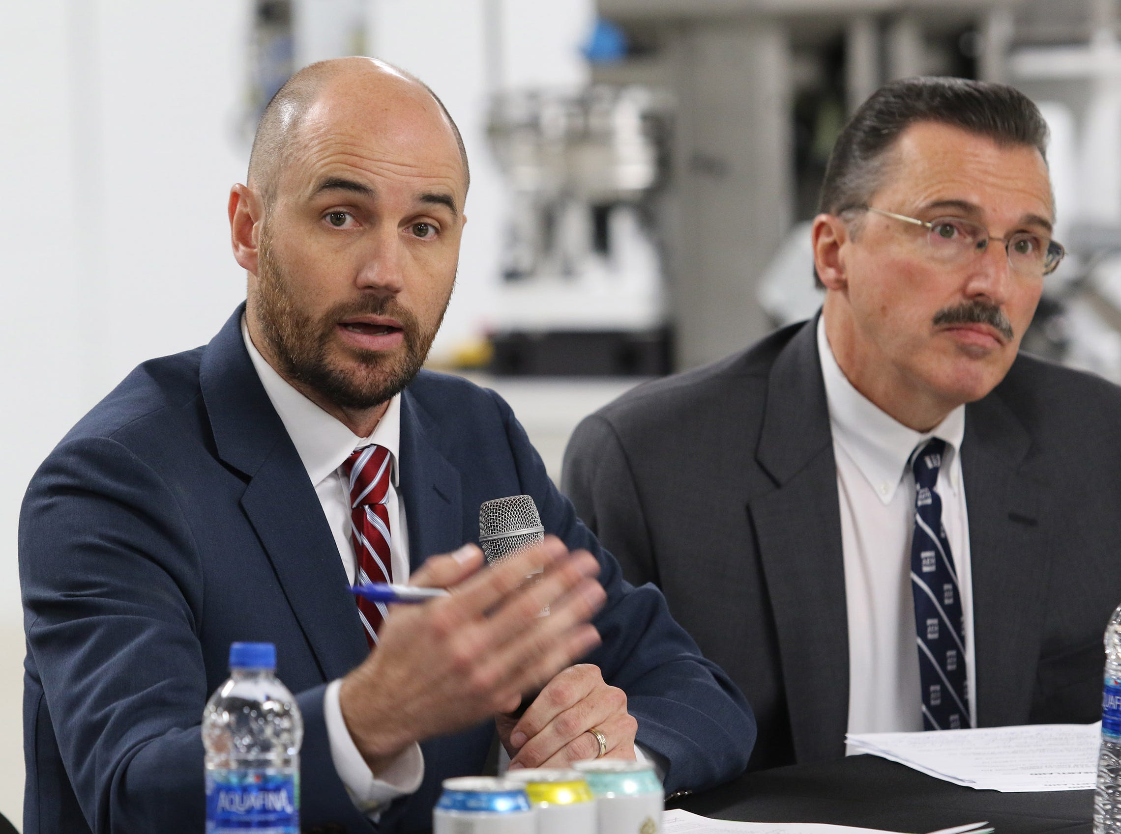 US Chamber of Commerce Midwest Region Executive Director John Kirchner (left) talks about the impact of tariffs on Wisconsin businesses during a tariff town hall at Husco International in Waukesha on Oct. 25. The event was organized by Tariffs Hurt the Heartland.