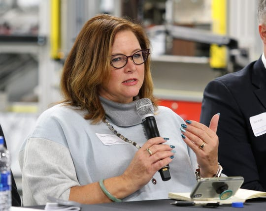 Susan Quam, executive vice president of the Wisconsin Restaurant Association, talks about the impact of tariffs on Wisconsin's restaurants during a tariff town hall at Husco International in Waukesha on Oct. 25.
