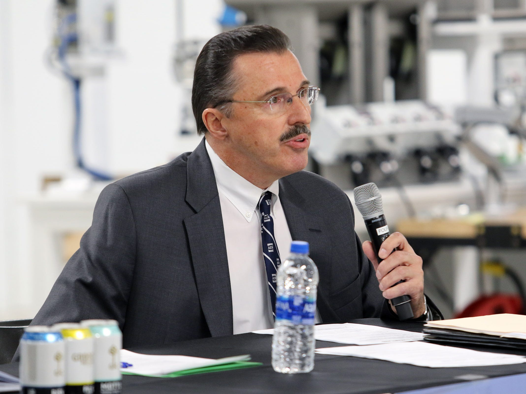 Dennis Slater, president of the Association of Equipment Manufacturers, served as moderator for a panelist discussion on the impact of tariffs on Wisconsin businesses and farmers during a tariff town hall at Husco International, Waukesha, on Oct. 25. The town hall was organized by Tariffs Hurt the Heartland.