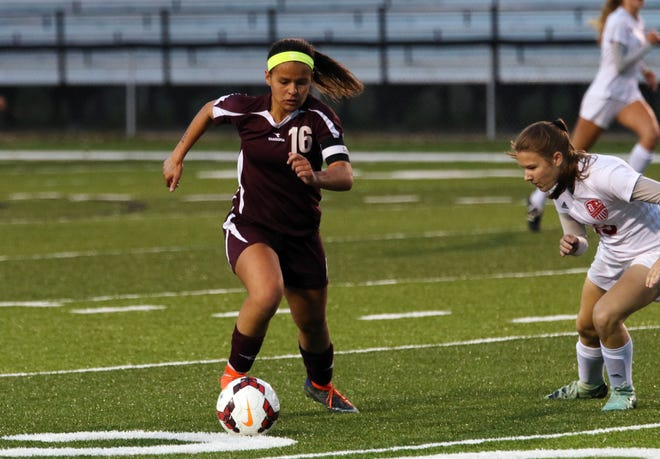 John Glenn's Ashley Townsend moves with the ball against Dover in the district final. Townsend was voted the Division II girls soccer player of the year.