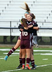 John Glenn celebrates Angela Kumler's goal against Dover.