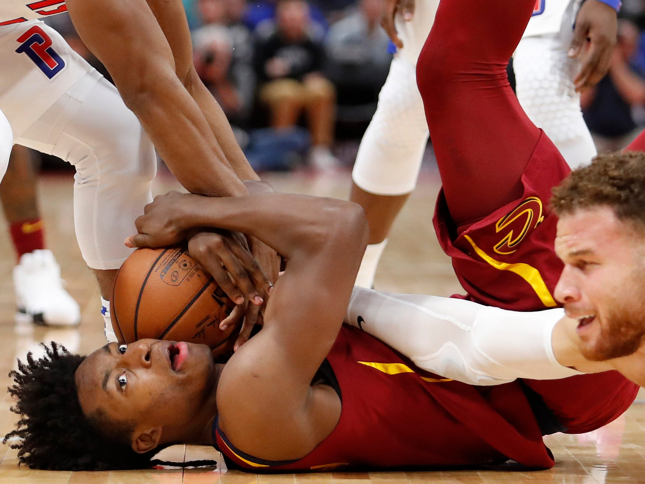 Oct. 25: Cavaliers guard Collin Sexton hits the deck to corral a loose ball during the fourth quarter against the Pistons in Detroit.
