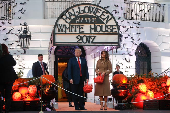 "In this 2017 photo, President Donald Trump and first lady Melania Trump celebrate Halloween on the South Lawn. A Change.org petition is asking Trump to ""Join the Saturday Halloween Movement"" and change the day Americans celebrate Halloween."