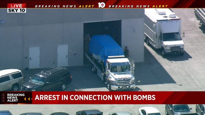 In this still image taken from a video courtesy of television station WPLG, a van covered in blue tarp arrives at an FBI facility on October 26, 2018, in Florida, in connection with the suspicious packages mailed to top Democrats.