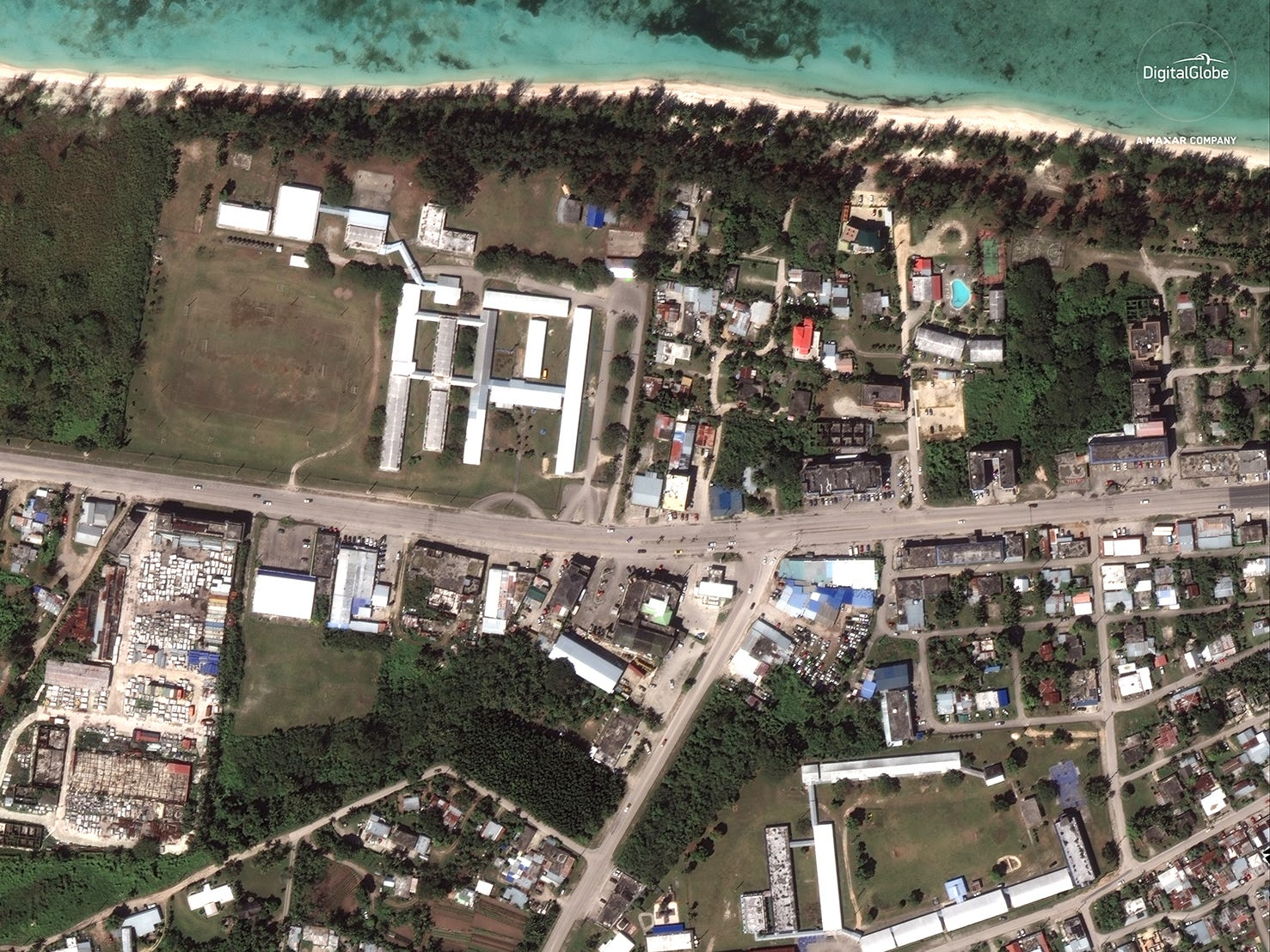DigitalGlobe's WorldView-3 satellite made this photo of the northern Mariana Islands of Saipan and Tinian. The next photo in the gallery shows the same location after the aftermath of the Category 5 Typhoon Yutu.