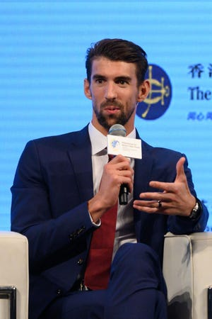 US Olympic swimming legend Michael Phelps speaks as part of a panel during the Philanthropy for Better Cities Forum event in Hong Kong on September 21, 2018.
