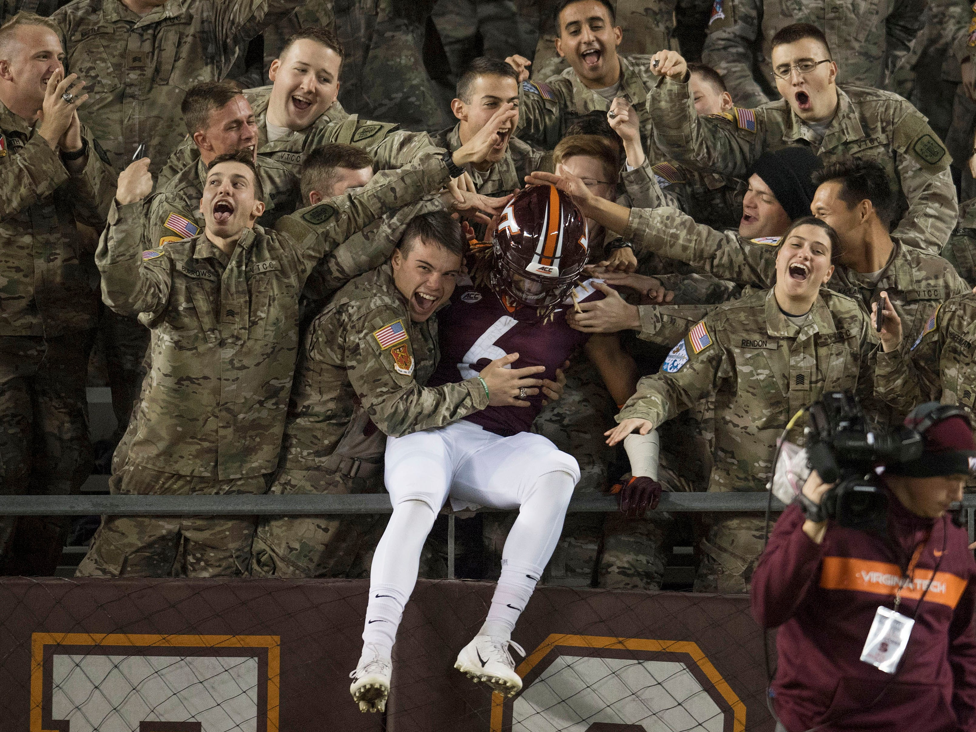 Virginia Tech wide receiver Hezekiah Grimeley jumped into the stands with the keydets prior to the game against Georgia Tech at Lane Stadium.