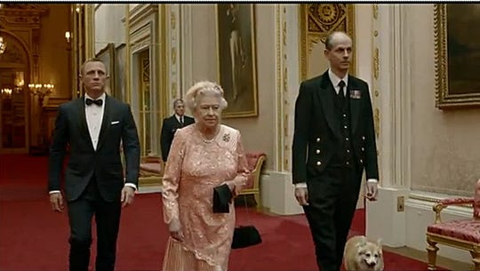 Queen Elizabeth II is left by Daniel Craig (James Bond), a palace butler and one of her corgis in a parody of the opening of the 2012 London Olympics.