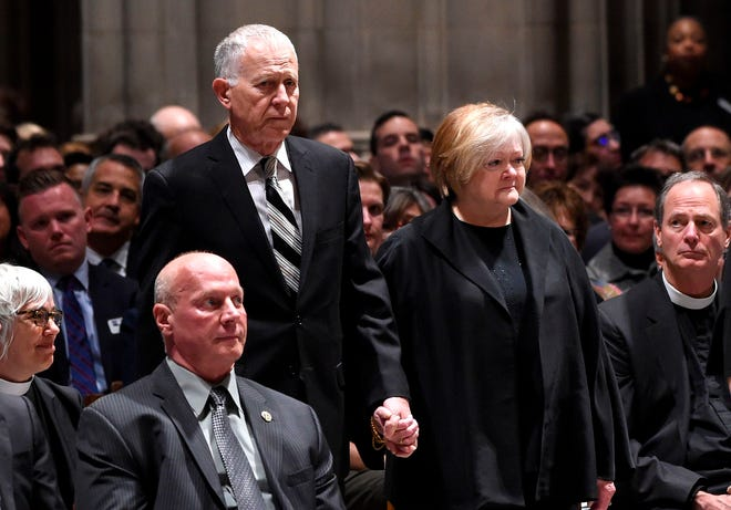 Judy and Dennis Shepard attend the interment ceremony for their son, Matthew Shepard, at the Washington National Cathedral on Oct. 25, 2018, in Washington, DC.  Two decades ago, the brutal killing of Matthew Shepard, a 21-year-old gay college student, sent shockwaves across the United States, raising awareness about violence against homosexuals and prompting calls for tougher federal hate crime laws.