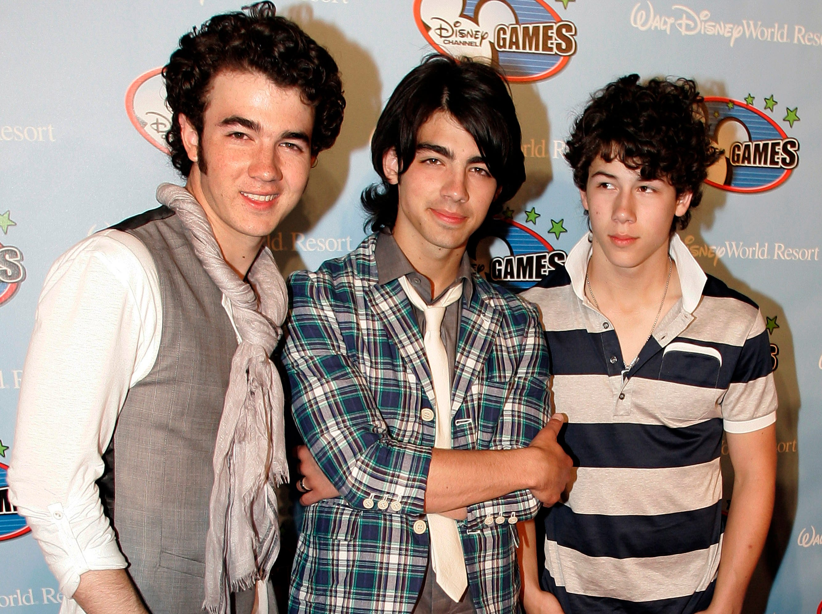 ** FILE ** In this May 2, 2008 file photo, The Jonas Brothers, from left, Kevin Jonas, Joe Jonas and Nick Jonas, pose on the red carpet for the Disney Channel Games in Lake Buena Vista, Fla. (AP Photo/Reinhold Matay, file) ORG XMIT: FLRM204