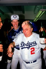 Tommy Lasorda, shown celebrating with Orel Hershiser after winning the NL West Division title in 1985, would guide the Dodgers to the World Series champinship three years later.