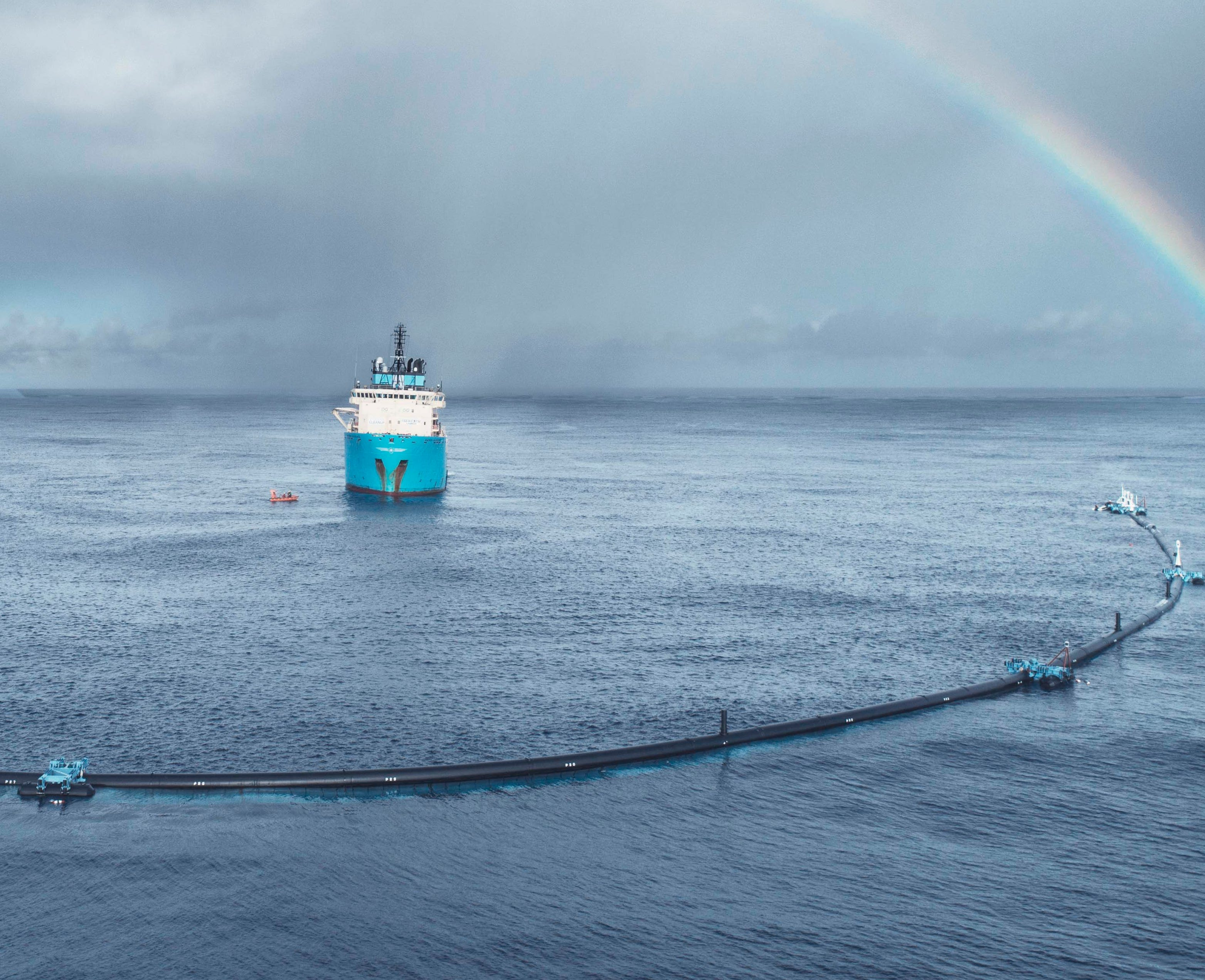 The Ocean Cleanup system deployed in the Great Pacific Garbage Patch to sweep up plastic trash at the ocean's surface.