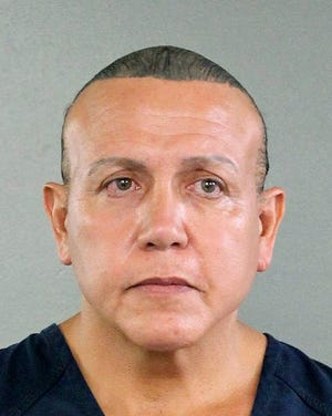 In this undated photo released by the Broward County Sheriff's office, Cesar Sayoc is seen in a booking photo in Miami. Federal authorities took  Sayoc, 56, of Aventura, Fla., into custody Friday, Oct. 26, 2018 in Florida in connection with the mail-bomb scare that earlier widened to 12 suspicious packages, the FBI and Justice Department said. (Broward County Sheriff's Office via AP)