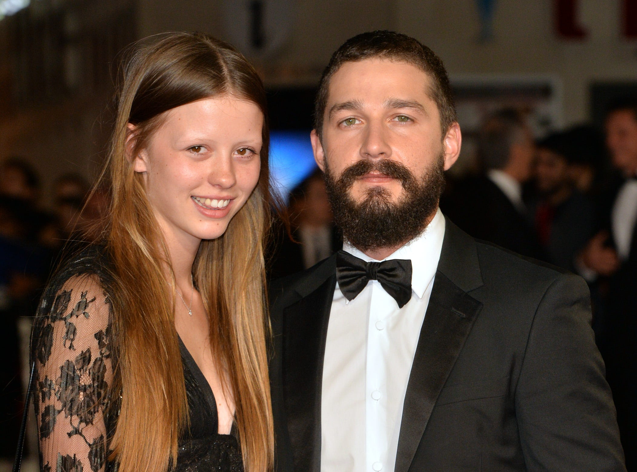 "LONDON, ENGLAND - OCTOBER 19:  Mia Goth and Shia LeBeouf attend the closing night European Premiere gala red carpet arrivals for ""Fury"" during the 58th BFI London Film Festival at Odeon Leicester Square on October 19, 2014 in London, England.  (Photo by Anthony Harvey/Getty Images for BFI) ORG XMIT: 517156461 [Via MerlinFTP Drop]"
