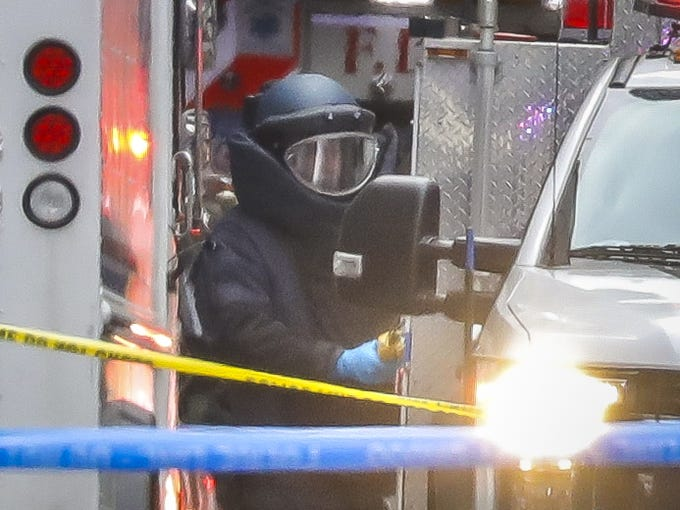 A bomb disposal technician carries a package out of a U.S. Post Office facility at 52nd Street and 8th Avenue in Manhattan, Oct. 26, 2018 in New York City. The latest package bomb device intercepted in New York City this morning was addressed to former Director of National Intelligence James Clapper at CNN's offices.