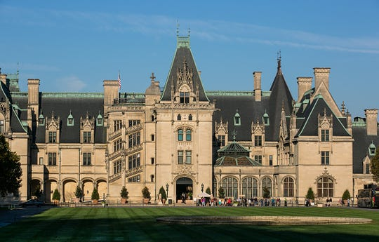 """ASHEVILLE, NC - OCTOBER 20: The Biltmore Estate, the largest privately owned home in America, built by George Vanderbilt between 1889 and 1895, is one of area's major tourist draws as viewed on October 20, 2016 in Asheville, North Carolina. Named one of the """"Top 10 Great Places to Retire"""" by AARP, Asheville is experiencing a major cultural revolution, with the addition of new residents, restaurants, live music, and a vibrant arts community. (Photo by George Rose/Getty Images)"""