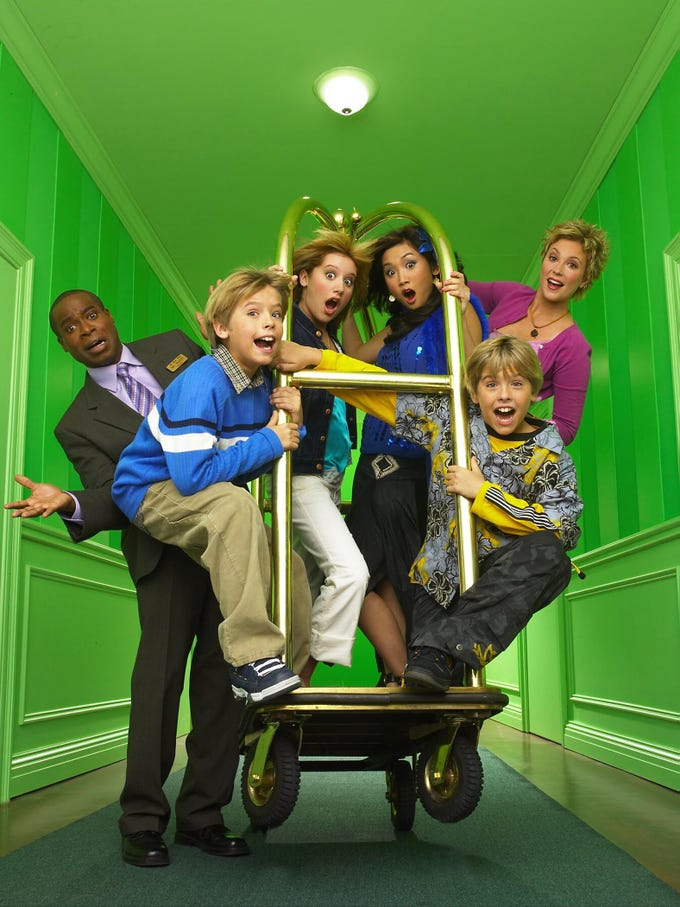 "The Suite Life of Zack & Cody  -- Pictured (LtoR) Phill Lewis, Dylan Sprouse, Ashley Tisdale, Brenda Song, Kim Rhodes and Cole Sprouse. Disney Channel's newest live-action hit, ""The Suite Life of Zack & Cody,"" is a comedy for kids age 6-14. ""The Suite Life of Zack & Cody"" (11:00 a.m., ET/10:00 a.m., PT), new to ABC Kids and starring identical twins Dylan and Cole Sprouse (""Big Daddy,"" ""Friends""), Ashley Tisdale and Brenda Song (Disney Channel's ""Phil of the Future"" and ""Stuck in the Suburbs""), is a situation comedy that tracks the antics of twin 12-year-old boys, Zack and Cody, whose single mom Carey (Kim Rhodes) gets a job as headlining singer at an upscale hotel in Boston and as part of her contract, an upper floor suite where they all live now. The hotel comes complete with room service, a swimming pool, game room, candy counter and many new friends for the twins to get to know including Maddie, the candy counter clerk and frequent babysitter, as well as London, the hotel owner's spoiled daughter. To the chagrin of the hotel manager, Mr. Moseby (Phill Lewis), the twins turn the hotel into their playground, and the staff and guests into unwitting participants in the outrageous situations they manage to create. (DISNEY)  (Via MerlinFTP Drop)"