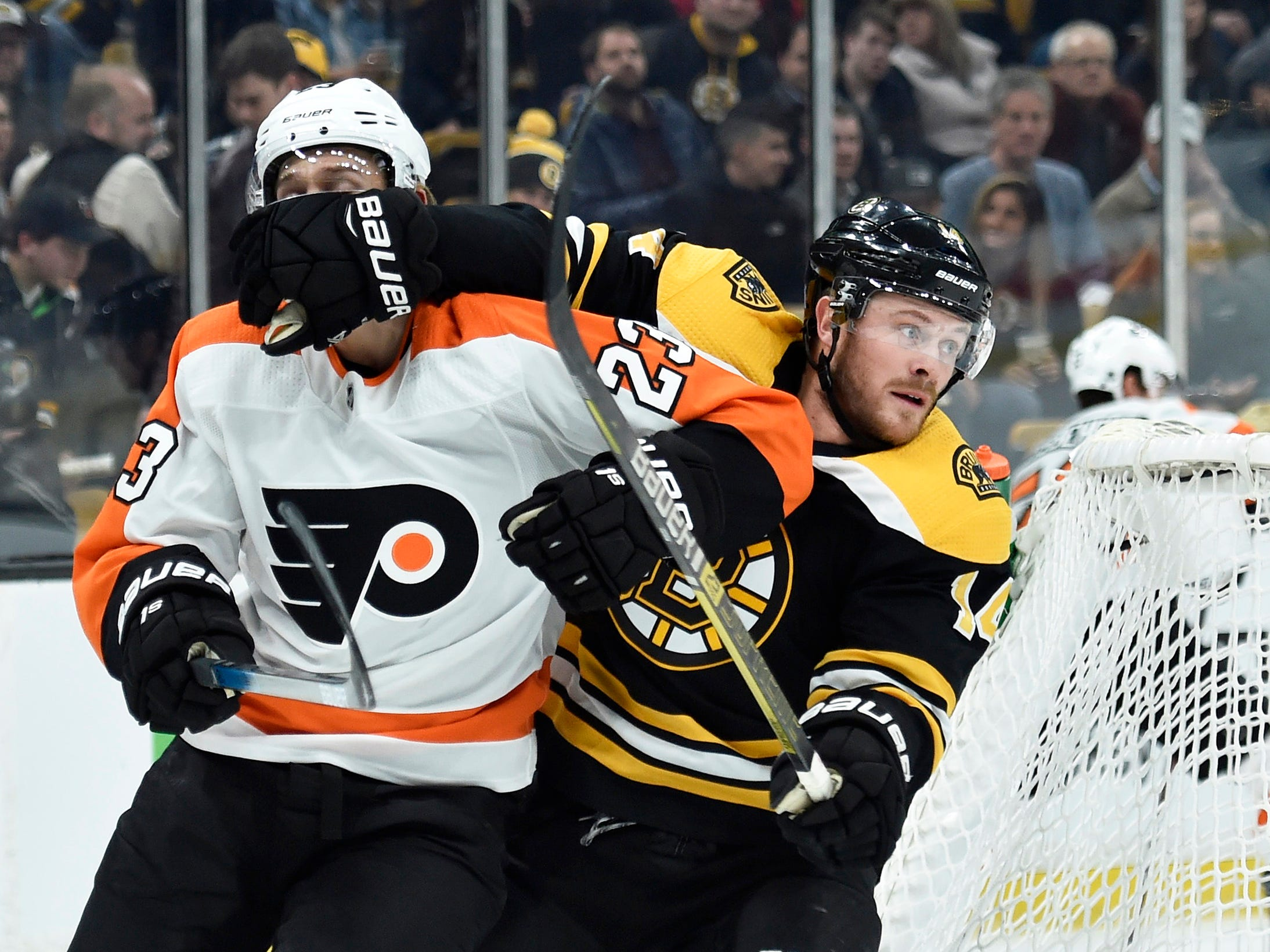 Oct. 25: The Boston Bruins' Chris Wagner and Philadelphia Flyers' Oskar Lindblom battle for position during the first period at TD Garden. The Bruins won the game, 3-0.