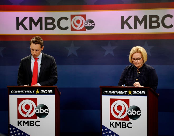 Missouri U.S. Senate candidates incumbent Democratic Sen. Claire McCaskill, right, and Republican challenger Josh Hawley look over their notes before the start of a debate Thursday, Oct. 25, 2018, in Kansas City, Mo.