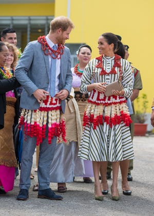 Prince Harry and Duchess Meghan visit an exhibition of Tongan handicrafts, mats and tapa cloths at the Fa'onelua Convention Center in Nuku'alofa, Tonga.