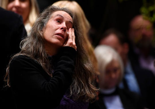 A woman reacts as she attends the remembrance ceremony for Matthew Shepard at the Washington National Cathedral on Oct. 26, 2018, in Washington, DC.  Two decades ago the brutal killing of Matthew Shepard, a 21-year-old gay college student, sent shockwaves across the United States, raising awareness about violence against homosexuals and prompting calls for tougher federal hate crime laws.