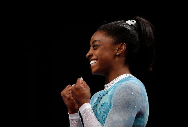 Simone Biles smiles during warmup for the U.S. Gymnastics Championships at TD Garden in August.