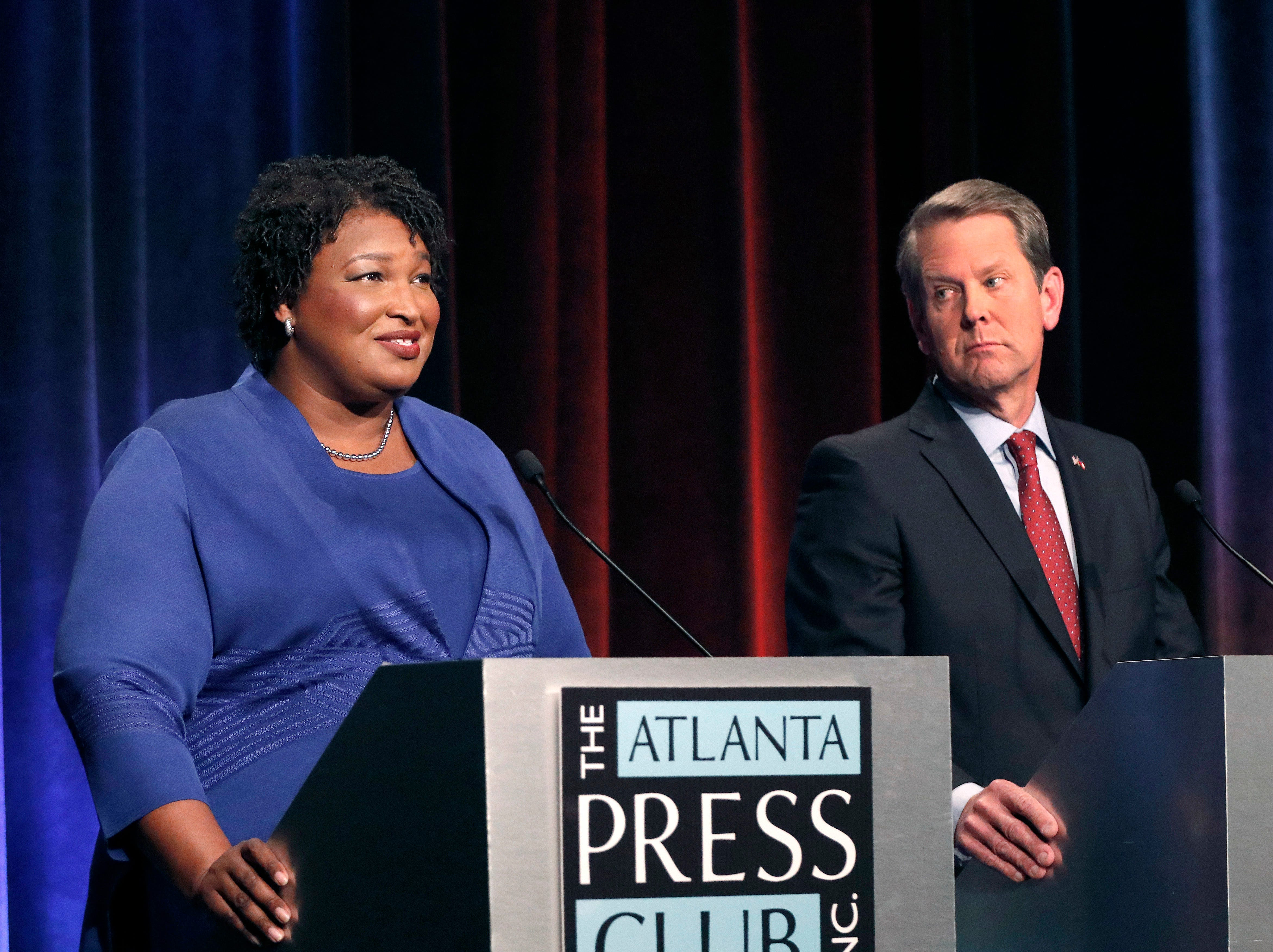 Brian Kemp declares victory in Georgia governor race as Stacey Abrams waits for results