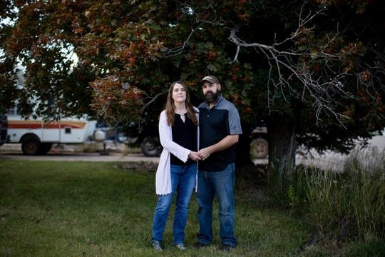 Kristen Kilmer and her husband, Chet Kilmer, stand outside their home in Spearfish, S.D.
