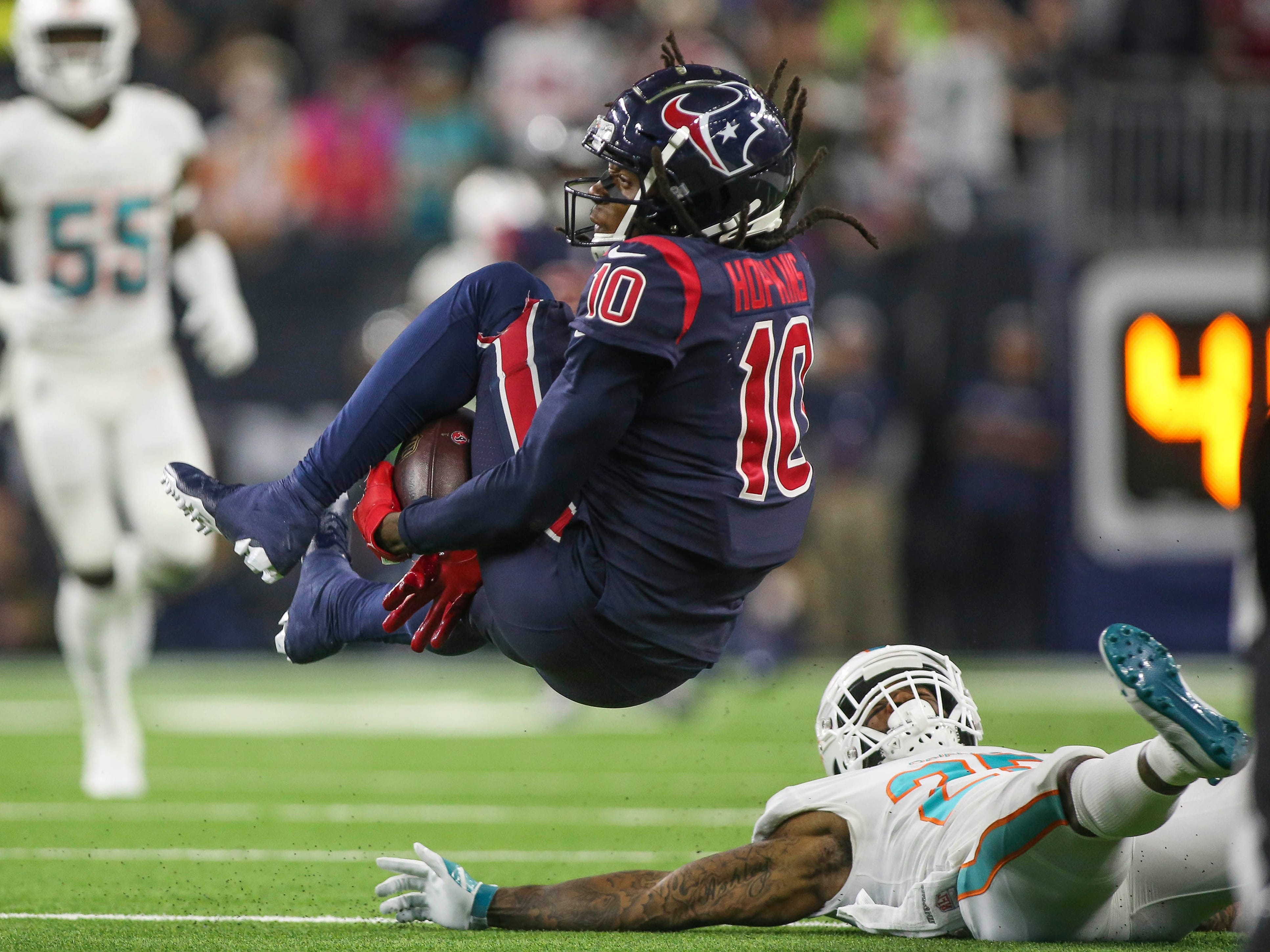 Week 8: Houston Texans wide receiver DeAndre Hopkins attempts to make a reception during the third quarter against the Miami Dolphins at NRG Stadium. The Texans won the game, 42-23.