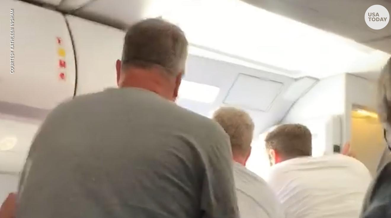 Frontier Airlines passenger opens cabin door on plane