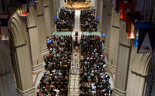 """Dennis and Judy Shepard, Bishop LaTrelle Easterling, Rev. Mariann Budde, Rev. V. Gene Robinson and the ashes of Matthew Shepard are carried at the conclusion of a """"Thanksgiving and Remembrance of Matthew Shepard"""" service at Washington National Cathedral in Washington, on Friday, Oct. 26, 2018. The ashes of Matthew Shepard, whose brutal murder in the 1990s became a rallying cry for the gay rights movement, was laid to rest in Washington National Cathedral."""