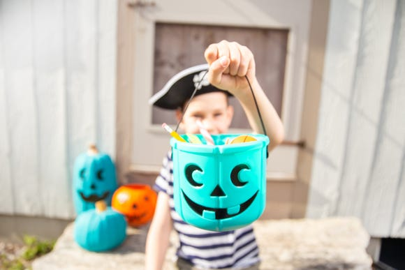 If a trick-or-treater carrying a teal pumpkin bucket shows up at your door this Halloween, it means he or she has a food allergy. Consider having a stash of non-food treats like vampire fangs or bouncy balls to hand out.
