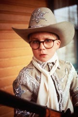 Ralphie imagines he's a hero who saves everyone, with the help of his Red Ryder BB gun.