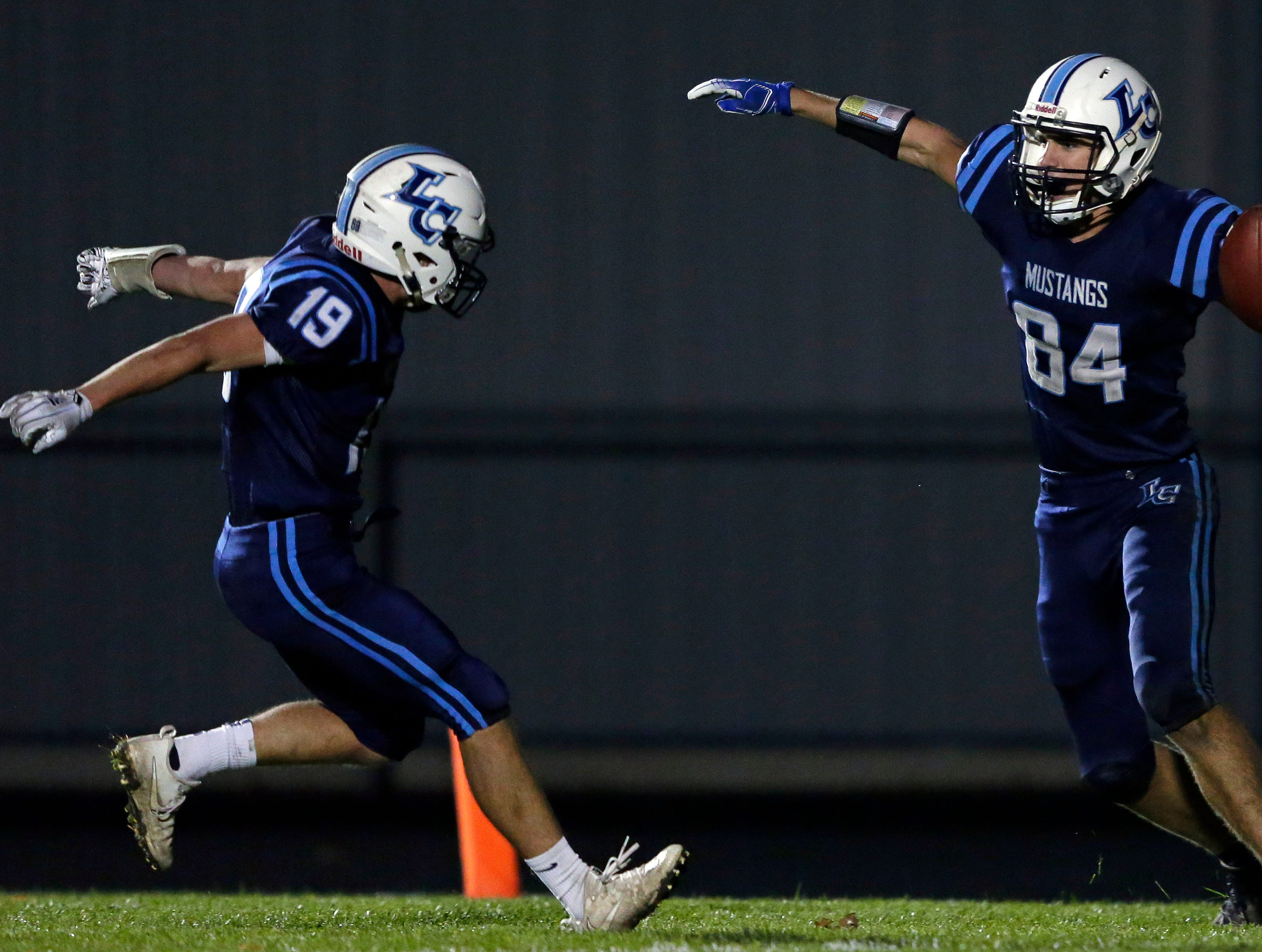 Jacob Lillge (left) of Little Chute celebrates Isiah Boe's touchdown against Chilton in a WIAA Division 4 second round football playoff game Friday, October 26, 2018, at Little Chute High School in Little Chute, Wis.Ron Page/USA TODAY NETWORK-Wisconsin